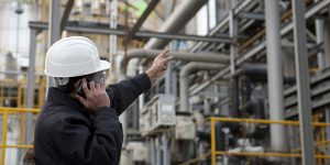 oil refinery engineer pointing against pipelinemy collection lightbox
